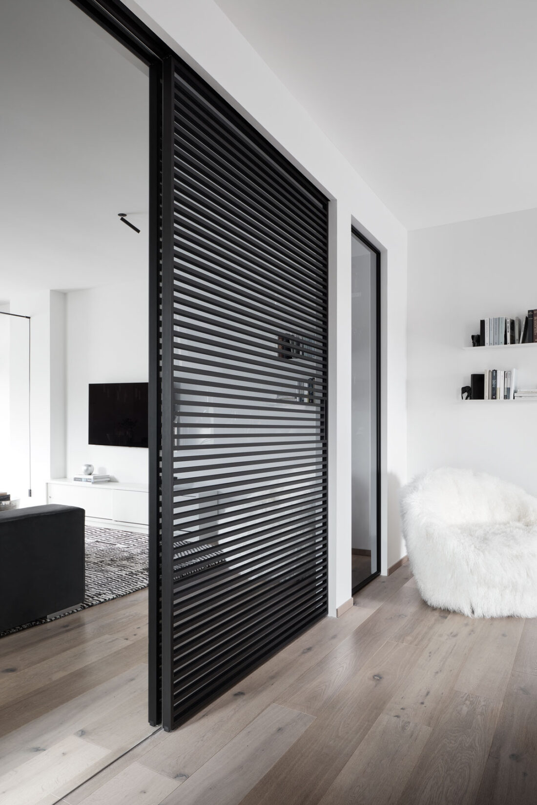 sliding glass door with stripes in a modern living room
