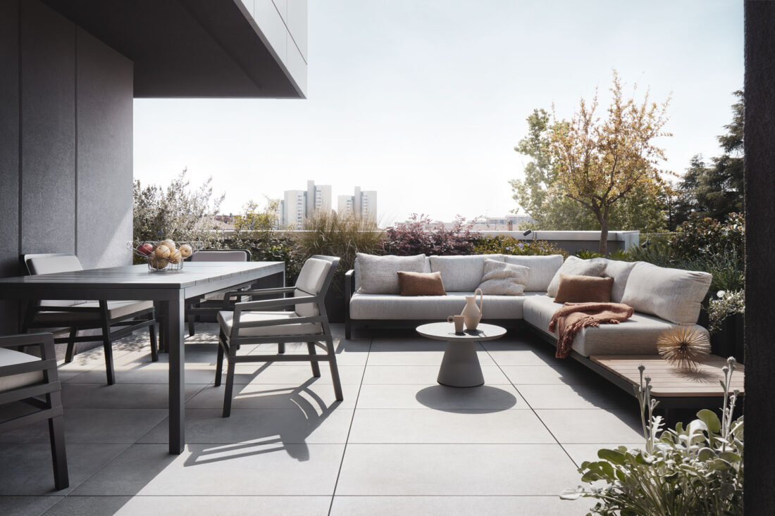 modern penthouse terrace with outdoor furniture and plants